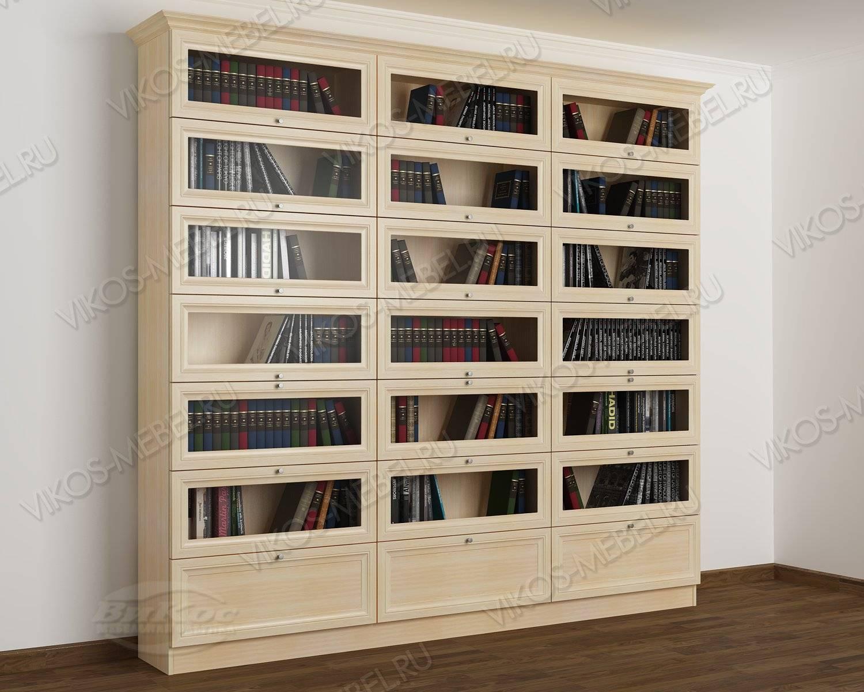 Трехстворчатый книжный шкаф со стеклянными дверями библиотек.