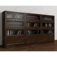 Низкий темный книжный шкаф с фигурным фасадом